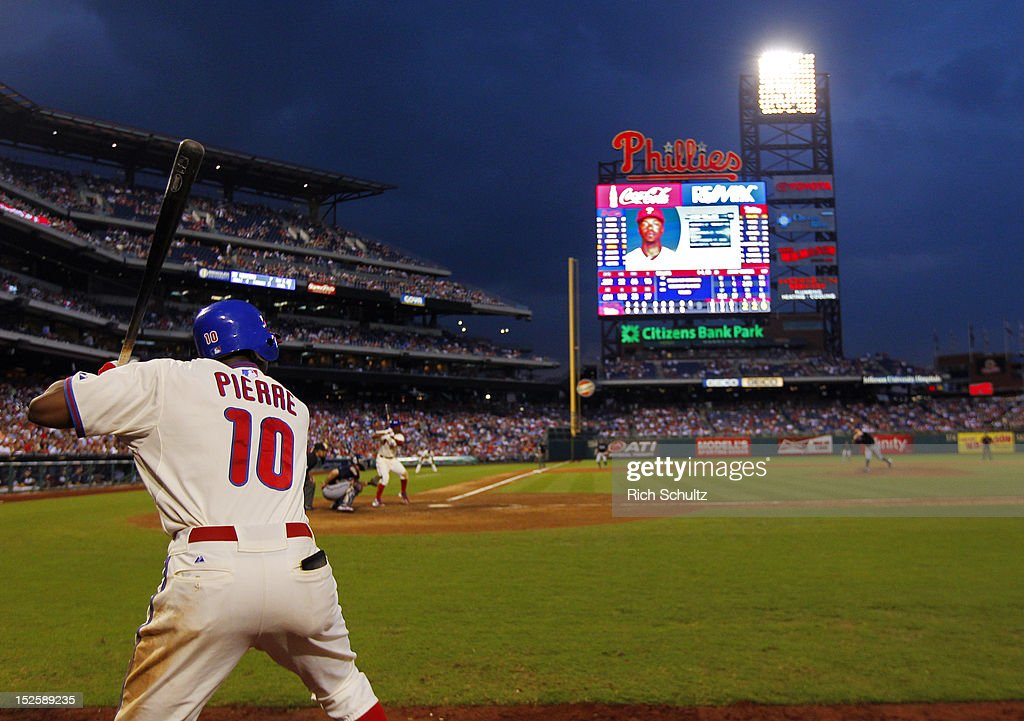 <a gi-track='captionPersonalityLinkClicked' href=/galleries/search?phrase=Juan+Pierre&family=editorial&specificpeople=202961 ng-click='$event.stopPropagation()'>Juan Pierre</a> #10 of the Philadelphia Phillies stands in the on deck circle as teammate Jimmy Rollins #11 bats in the eighth inning against the Atlanta Braves during a MLB baseball game on September 22, 2012 at Citizens Bank Park in Philadelphia, Pennsylvania. The Braves defeated the Phillies 8-2.