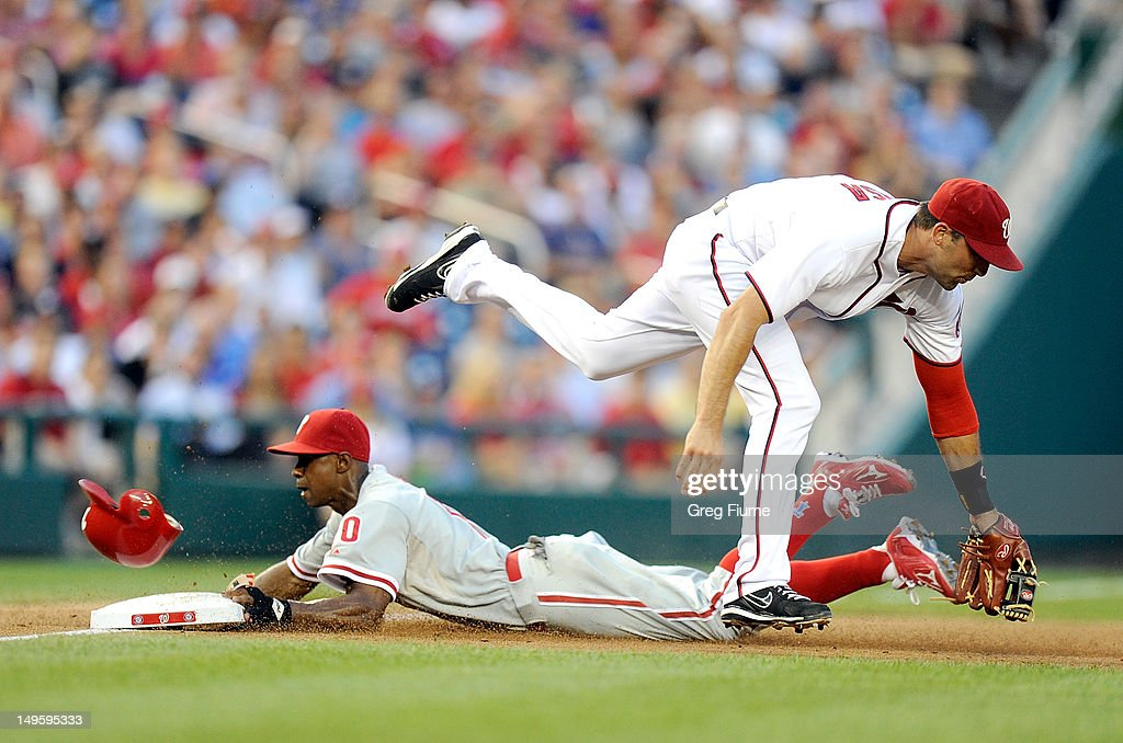 <a gi-track='captionPersonalityLinkClicked' href=/galleries/search?phrase=Juan+Pierre&family=editorial&specificpeople=202961 ng-click='$event.stopPropagation()'>Juan Pierre</a> #10 of the Philadelphia Phillies steals third base in the third inning as the throw gets by <a gi-track='captionPersonalityLinkClicked' href=/galleries/search?phrase=Mark+DeRosa&family=editorial&specificpeople=228401 ng-click='$event.stopPropagation()'>Mark DeRosa</a> #7 of the Washington Nationals at Nationals Park on July 31, 2012 in Washington, DC.