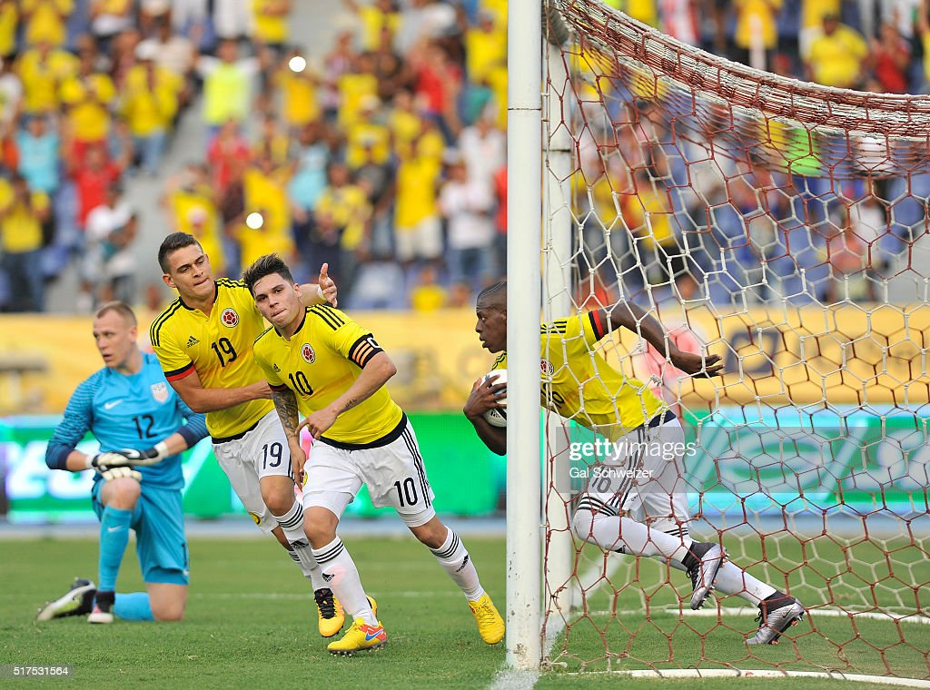 Juan Quintero of Colombia celebrates with teammates after scoring the first goal of his team during a U23 Olympic Qualifying Playoff match between...