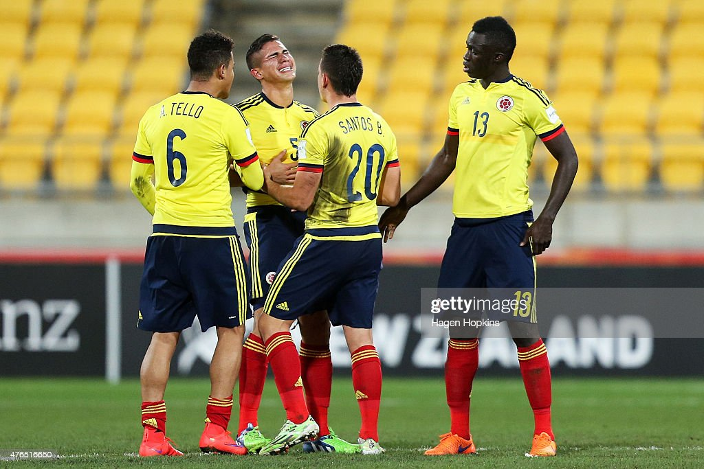 Juan Quintero of Colombia is consoled by teammates Andres Tello Santos Borre and Davinson Sanchez after the final whistle during the FIFA U20 World...
