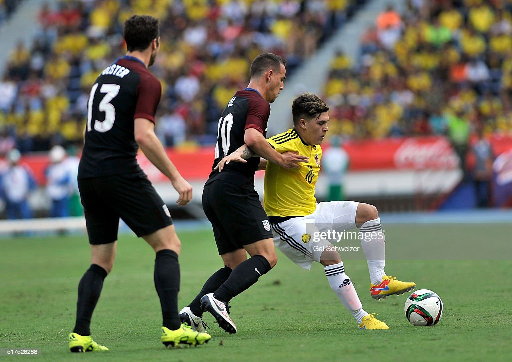 Juan Quintero of Colombia struggles for the ball with Luis Gil of US during a U23 Olympic Qualifying Playoff match between Colombia and USA at...