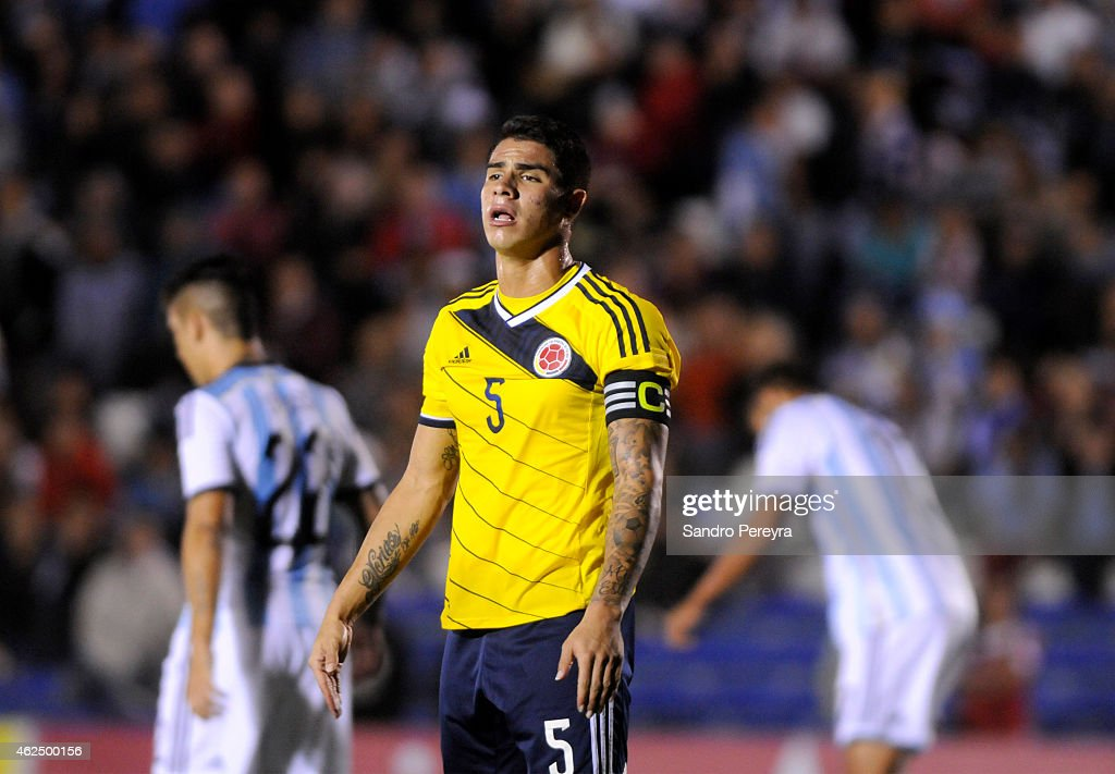 Juan Quintero of Colombia takes a breath during a match between Argentina and Colombia as part of South American U20 at Parque Central Stadium on...