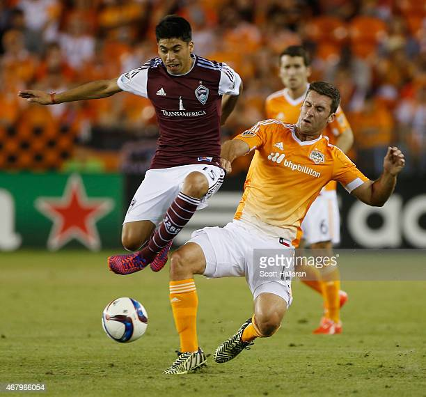 Juan Ramirez of the Colorado Rapids battles for the ball with Will Bruin of the Houston Dynamo during their game at BBVA Compass Stadium on March 28...