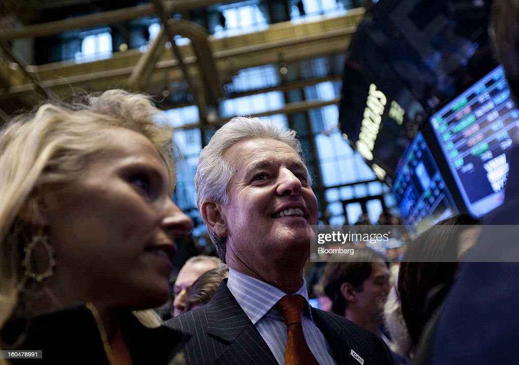 Juan Ramon Alaix, chief executive officer of Zoetis Inc., center, smiles after ringing the opening bell at the New York Stock Exchange (NYSE) in New York, U.S., on Friday, Feb. 1, 2013. Zoetis Inc., the animal-health company owned by Pfizer Inc., surged as much as 22 percent in its debut after raising $2.24 billion in its initial public offering, pricing the shares above the proposed price range. Photographer: Jin Lee/Bloomberg via Getty Images