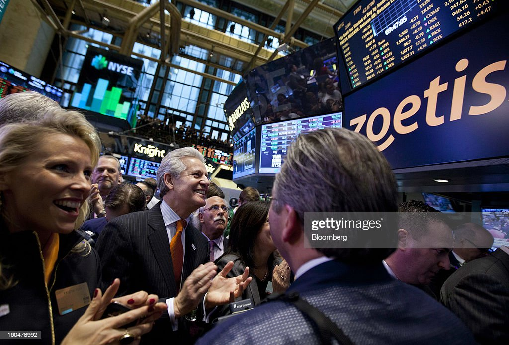 Juan Ramon Alaix, chief executive officer of Zoetis Inc., second right, applauds after ringing the opening bell at the New York Stock Exchange (NYSE) in New York, U.S., on Friday, Feb. 1, 2013. Zoetis Inc., the animal-health company owned by Pfizer Inc., surged as much as 22 percent in its debut after raising $2.24 billion in its initial public offering, pricing the shares above the proposed price range. Photographer: Jin Lee/Bloomberg via Getty Images