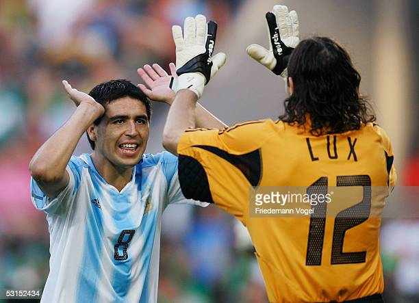 Juan Riquelme and German Lux of Argentina celebrate during the penalty shootout in the Semi Final match between Mexico and Argentina for the FIFA...
