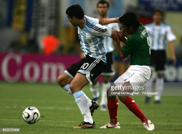 Juan Riquelme Argentina and Pavel Pardo Mexico battle for the ball