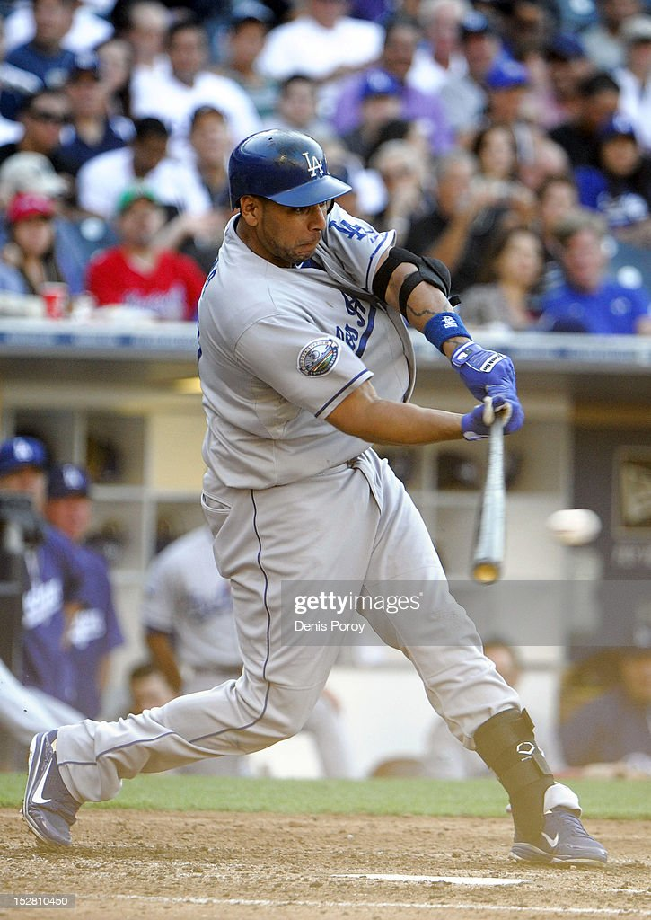 Juan Rivera #21 of the Los Angeles Dodgers hits a single during the fiifth inning of a baseball game against the San Diego Padres at Petco Park on September 26, 2012 in San Diego, California.