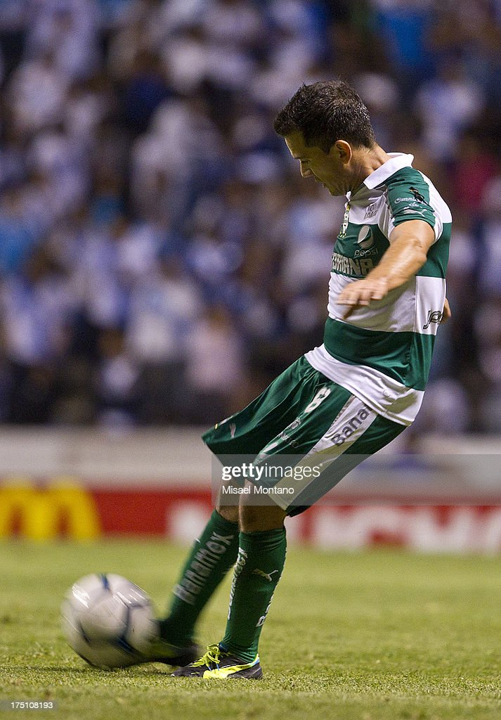 Juan Rodriguez of Santos during a match between Puebla and Santos as part of the Torneo de Apertura 2013 Liga MX Championship at Cuauhtemoc Stadium, on July 31, 2013 in Puebla, Mexico.