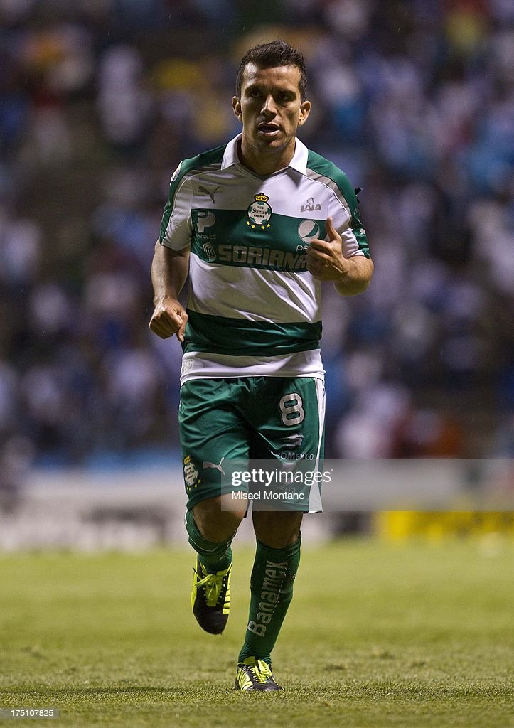 Juan Rodriguez of Santos in action during a match between Puebla and Santos as part of the Torneo de Apertura 2013 Liga MX Championship at Cuauhtemoc Stadium, on July 31, 2013 in Puebla, Mexico.