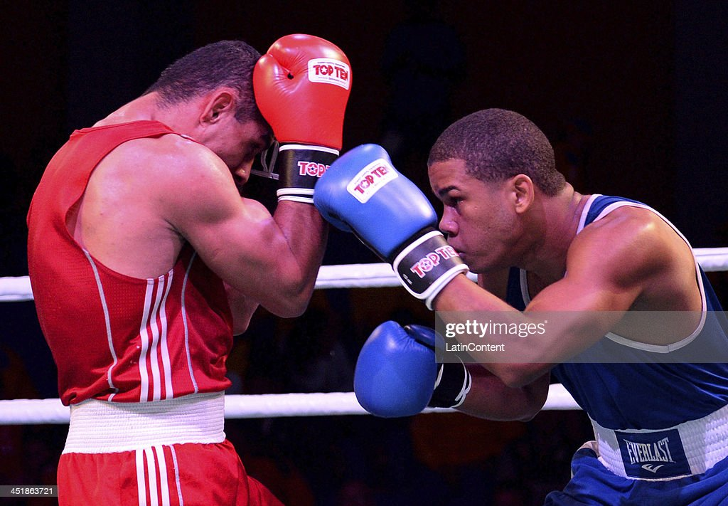 Juan Rodriguez of Venezuela (RED) fights with Daniel Santos of Dominican Republic (BLUE) in Men's 75 kg as part of the XVII Bolivarian Games Trujillo 2013 at Colegio Nuestra Señora del Rosario on November 24, 2013 in Chiclayo, Peru.