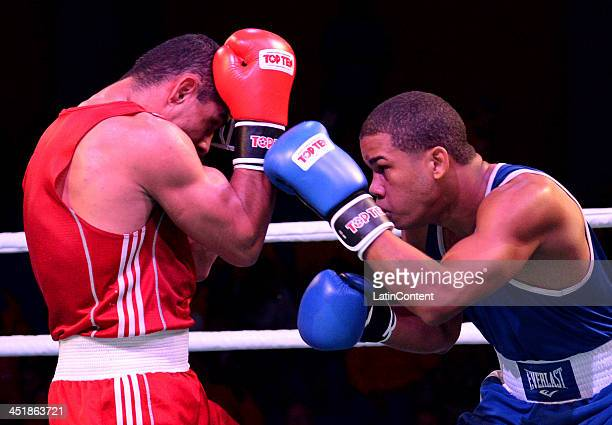 Juan Rodriguez of Venezuela fights with Daniel Santos of Dominican Republic in Men's 75 kg as part of the XVII Bolivarian Games Trujillo 2013 at...
