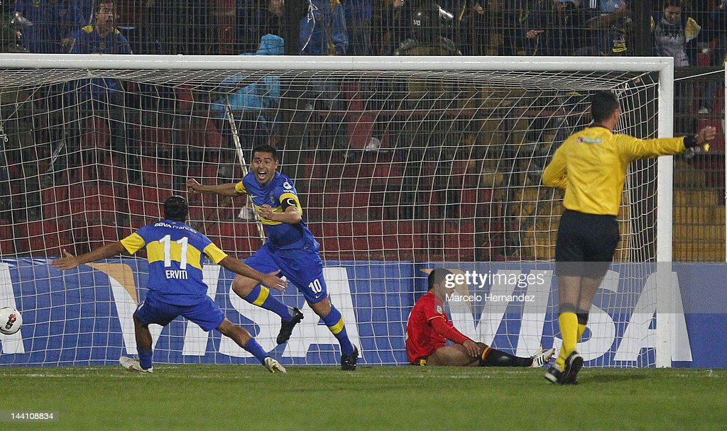 <a gi-track='captionPersonalityLinkClicked' href=/galleries/search?phrase=Juan+Roman+Riquelme&family=editorial&specificpeople=243174 ng-click='$event.stopPropagation()'>Juan Roman Riquelme</a> from Boca Juniors celebrates a scored goal during a match between Union Espanola and Boca Jrs. as part of the Copa Libertadores 2012 at Santa Laura Stadium on May 9, 2012 in Santiago , Chile.