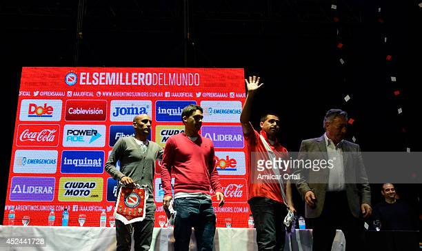 Juan Roman Riquelme greets during a press conference after his official unveiling as a new Argentinos Jrs player joined by Matías Caruzzo Cristian...