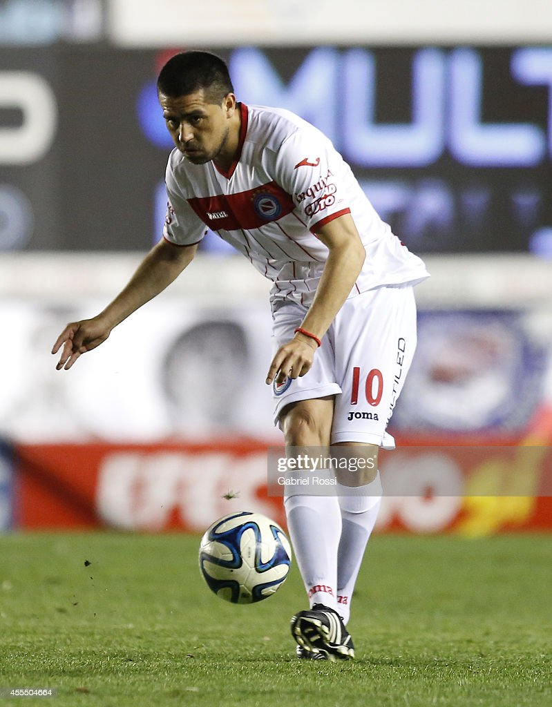 <a gi-track='captionPersonalityLinkClicked' href=/galleries/search?phrase=Juan+Roman+Riquelme&family=editorial&specificpeople=243174 ng-click='$event.stopPropagation()'>Juan Roman Riquelme</a> of Argentinos Juniors kicks the ball during a match between Argentinos Juniors and Colon as part of of Torneo de Transicion Nacional B 2014 at Julio Diego Armando Maradona Stadium on September 15, 2014 in Buenos Aires, Argentina.