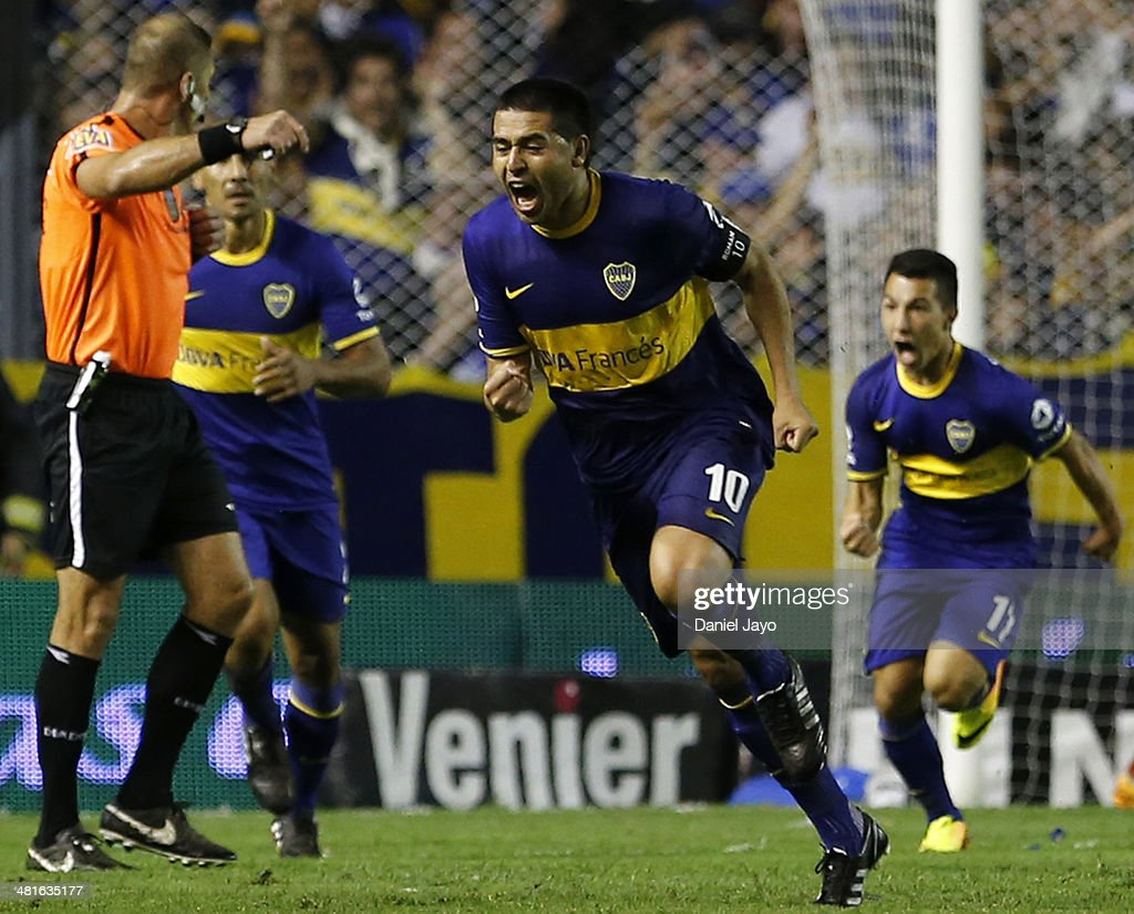 <a gi-track='captionPersonalityLinkClicked' href=/galleries/search?phrase=Juan+Roman+Riquelme&family=editorial&specificpeople=243174 ng-click='$event.stopPropagation()'>Juan Roman Riquelme</a>, of Boca Juniors, (C) celebrates after scoring during a match between Boca Juniors and River Plate as part of 10th round of Torneo Final 2014 at Alberto J. Armando Stadium on March 30, 2014 in Buenos Aires, Argentina.