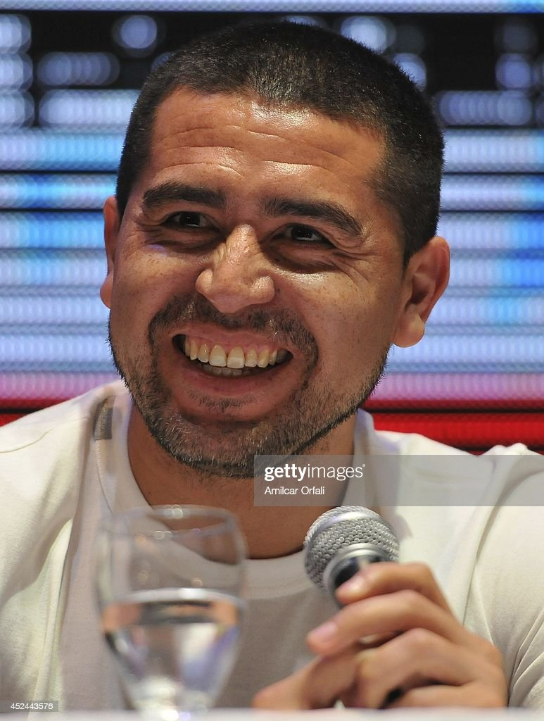 <a gi-track='captionPersonalityLinkClicked' href=/galleries/search?phrase=Juan+Roman+Riquelme&family=editorial&specificpeople=243174 ng-click='$event.stopPropagation()'>Juan Roman Riquelme</a> smiles during a press conference after his official unveiling as a new Argentinos Jrs player at Panamericano Hotel on July 20, 2014 in Buenos Aires, Argentina.