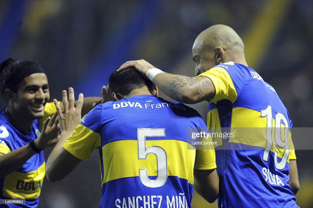 Juan Sanchez Miño from Boca Jrs celebrate a goal with teammates during the first leg of the Copa Libertadores 2012 semi-finals between Boca Jrs and Universidad de Chile at Bombonera Stadium on June 14, 2012 in Buenos Aires, Argentina.