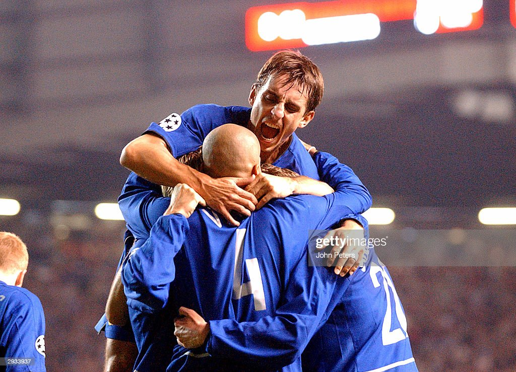 Juan Sebastian Veron celebrtaes after scoring with Phil Neville during the UEFA Champions League match between Manchester United v Olympiakos Piraeus at Old Trafford Stadium on October 1, 2002 in Manchester, England. Manchester United 4 Olympiakos Piraeus 0.