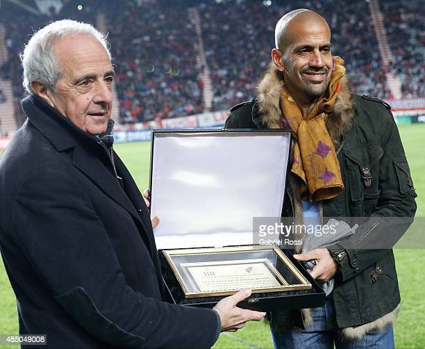 Juan Sebastian Veron former soccer player receives an award prior a match between Estudiantes and River Plate as part of 21st round of Torneo Primera...