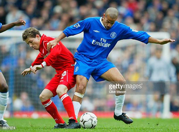 Juan Sebastian Veron of Chelsea battles for the ball with Juninho of Middlesbrough during the FA Barclaycard Premiership match between Chelsea and...