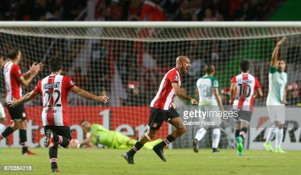 Juan Sebastian Veron of Estudiantes celebrates the opening goal scored by Javier Fabian Toledo of Estudiantes during a group stage match between...