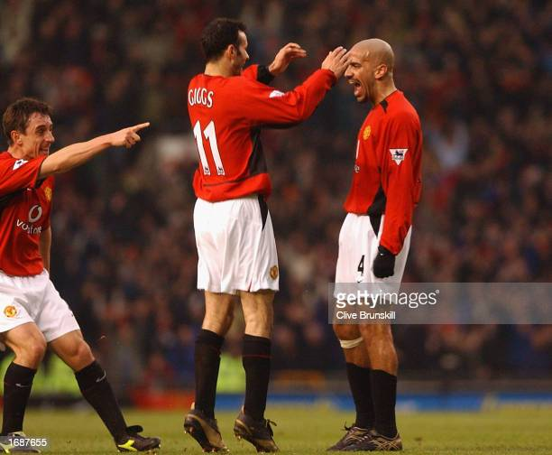 Juan Sebastian Veron of Manchester United celebrates scoring with his teammates during the FA Barclaycard Premiership match between Manchester United...