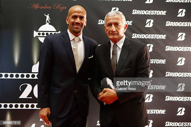 Juan Sebastian Veron President of Estudiates and his father Juan Ramon Veron former player of Estudiantes pose for pictures on the red carpet before...