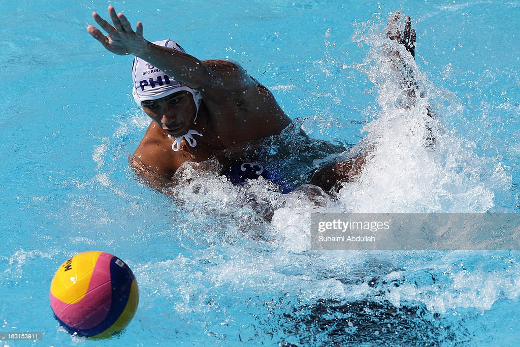 Juan Serrano Paolo of Philippines and Yahan Samarajeewa Chanidu of Sri Lanka fights for the ball during the Asian Water Polo Cup between Philippines and Sri Lanka at Toa Payoh Swimming Complex on October 5, 2013 in Singapore.