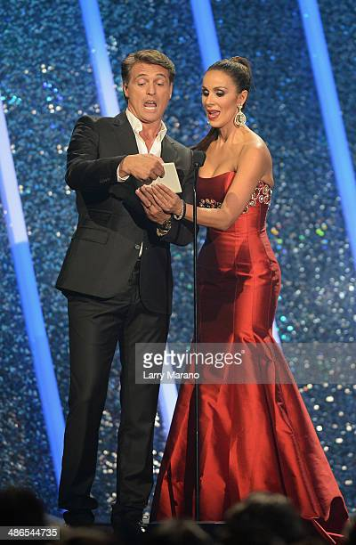 Juan Soler and Catherine Siachoque presents onstage during the 2014 Billboard Latin Music Awards at Bank United Center on April 24 2014 in Miami...