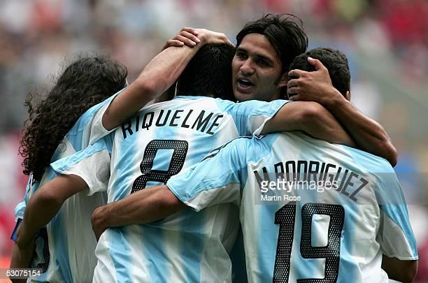 Juan SorinJuan Riquelme Mario Santana and Maximiliano Rodriguez of Argentina celebrates scoring the second goal during the FIFA Confederations Cup...
