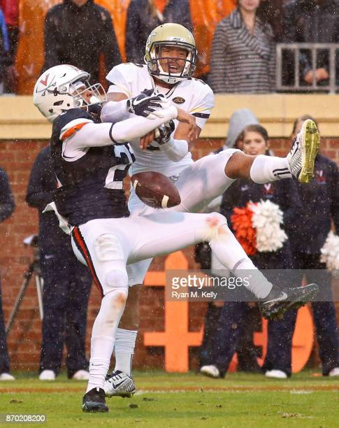 Juan Thornhill of the Virginia Cavaliers breaks up a pass intended for Ricky Jeune of the Georgia Tech Yellow Jackets in the second quarter during a...