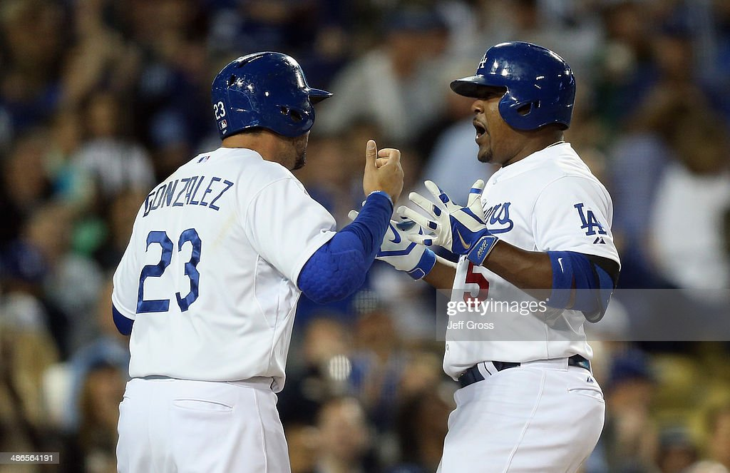 <a gi-track='captionPersonalityLinkClicked' href=/galleries/search?phrase=Juan+Uribe&family=editorial&specificpeople=209187 ng-click='$event.stopPropagation()'>Juan Uribe</a> (R) #5 of the Los Angeles Dodgers is congratulated by Adrian Gonzalez #23 after hitting a two-run home run against the Philadelphia Phillies in the fourth inning at Dodger Stadium on April 24, 2014 in Los Angeles, California.