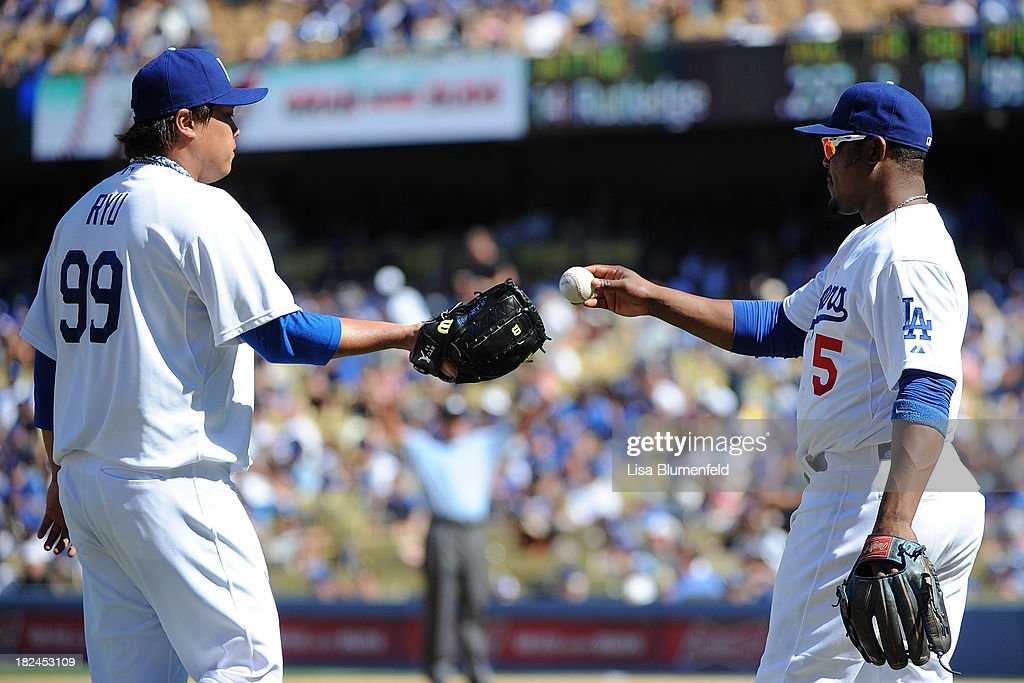 <a gi-track='captionPersonalityLinkClicked' href=/galleries/search?phrase=Juan+Uribe&family=editorial&specificpeople=209187 ng-click='$event.stopPropagation()'>Juan Uribe</a> #5 gives the ball to pitcher Hyun-Jin Ryu #99 of the Los Angeles Dodgers in the fourth inning against the Colorado Rockies at Dodger Stadium on September 29, 2013 in Los Angeles, California.