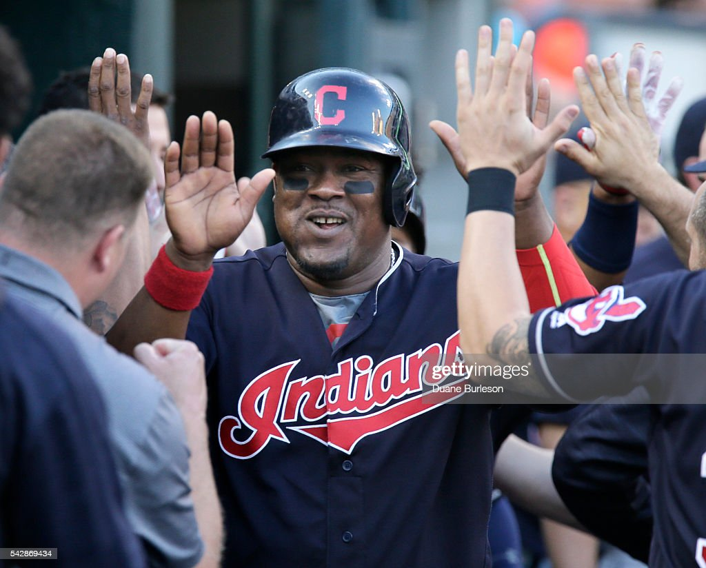 <a gi-track='captionPersonalityLinkClicked' href=/galleries/search?phrase=Juan+Uribe&family=editorial&specificpeople=209187 ng-click='$event.stopPropagation()'>Juan Uribe</a> #4 of the Cleveland Indians is congratulated in the dugout after scoring against the Detroit Tigers on a triple by Lonnie Chisenhall of the Cleveland Indians during the fourth inning at Comerica Park on June 24, 2016 in Detroit, Michigan.