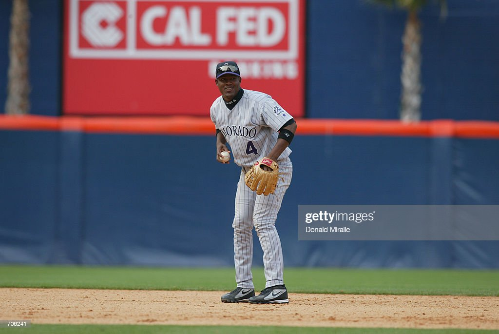 Juan Uribe of the Colorado Rockies looks to throw the ball during their game against the San Diego Padres on May 30 2002 at Qualcomm Stadium in San...
