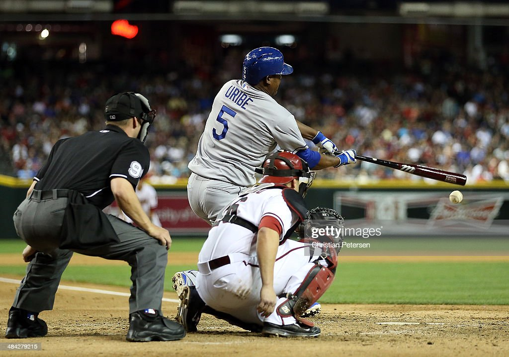 <a gi-track='captionPersonalityLinkClicked' href=/galleries/search?phrase=Juan+Uribe&family=editorial&specificpeople=209187 ng-click='$event.stopPropagation()'>Juan Uribe</a> #5 of the Los Angeles Dodgers bats against the Arizona Diamondbacks during the MLB game at Chase Field on April 11, 2014 in Phoenix, Arizona.