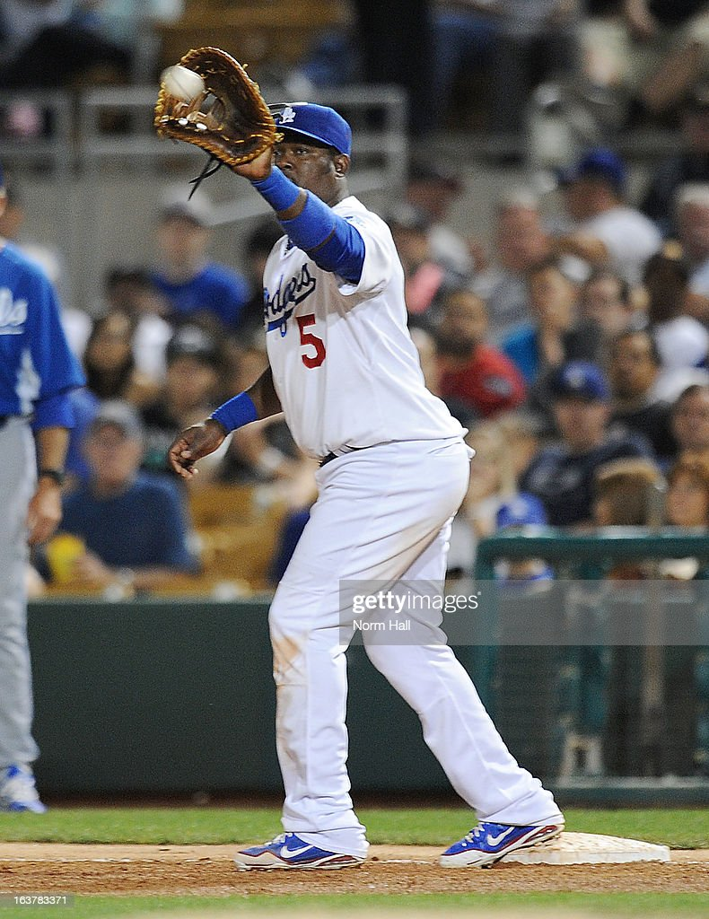 <a gi-track='captionPersonalityLinkClicked' href=/galleries/search?phrase=Juan+Uribe&family=editorial&specificpeople=209187 ng-click='$event.stopPropagation()'>Juan Uribe</a> #5 of the Los Angeles Dodgers catches a throw while covering first base against the Kansas City Royals on March 15, 2013 in Glendale, Arizona.