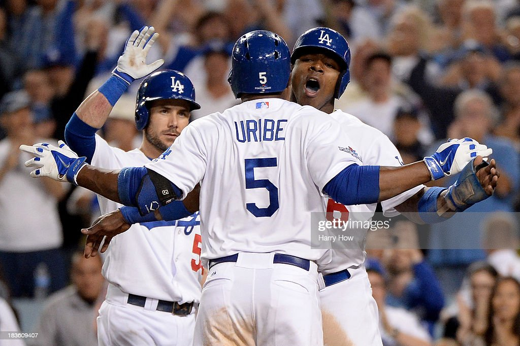 Juan Uribe of the Los Angeles Dodgers celebrates with Hanley Ramirez and Skip Schumaker after Uribe hits a tworun home run in the eighth inning...