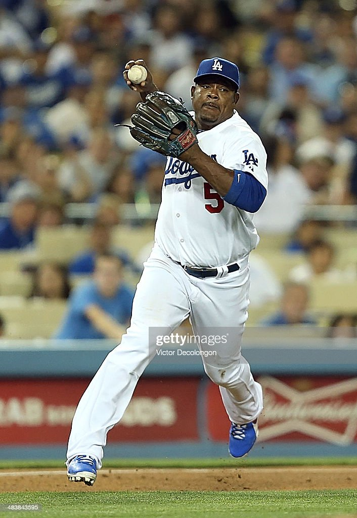 <a gi-track='captionPersonalityLinkClicked' href=/galleries/search?phrase=Juan+Uribe&family=editorial&specificpeople=209187 ng-click='$event.stopPropagation()'>Juan Uribe</a> #5 of the Los Angeles Dodgers fields a ground ball hit by Miguel Cabrera #24 of the Detroit Tigers (not in photo) in the sixth inning during the MLB game at Dodger Stadium on April 8, 2014 in Los Angeles, California. The Dodgers defeated the Tigers 3-2 in 10 innings.