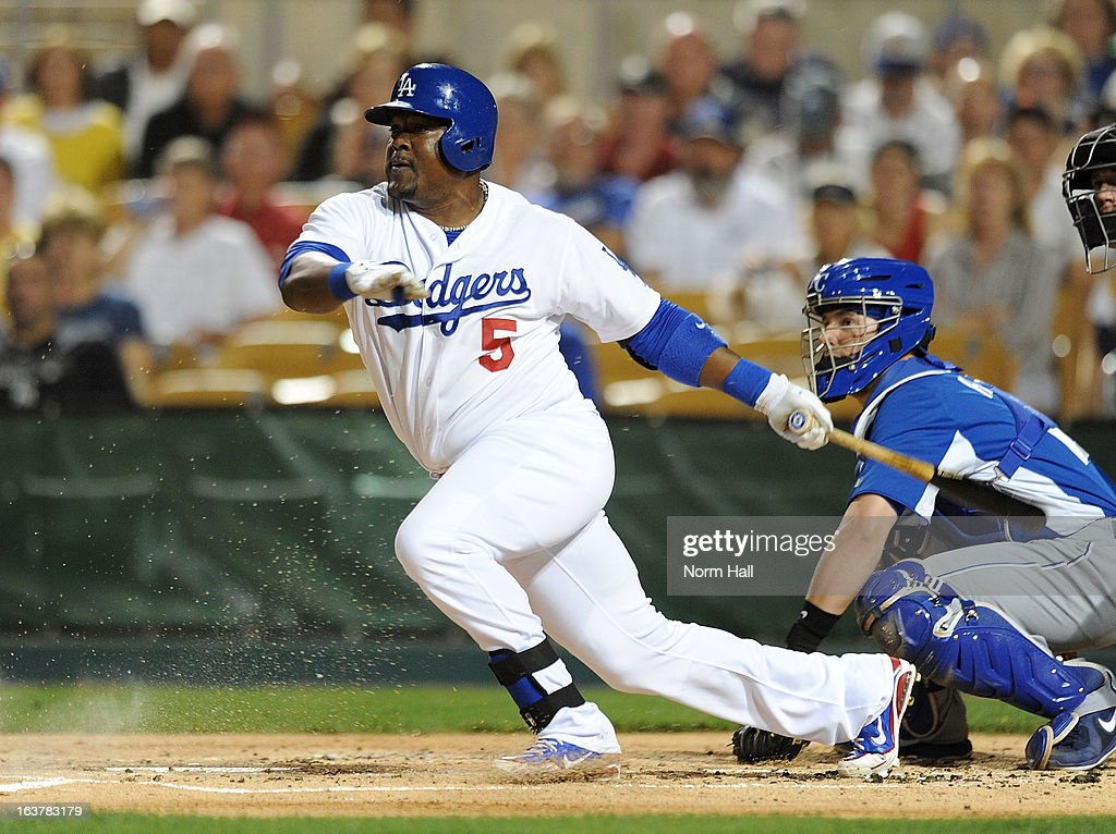 <a gi-track='captionPersonalityLinkClicked' href=/galleries/search?phrase=Juan+Uribe&family=editorial&specificpeople=209187 ng-click='$event.stopPropagation()'>Juan Uribe</a> #5 of the Los Angeles Dodgers follows through on a swing against the Kansas City Royals on March 15, 2013 in Glendale, Arizona.