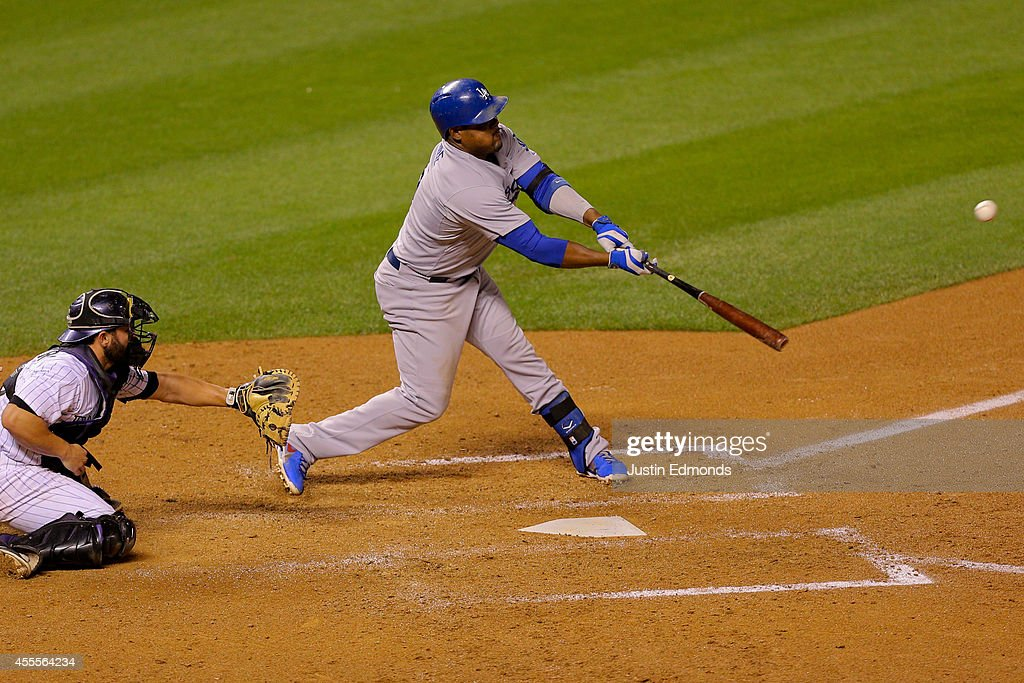 Juan Uribe #5 of the Los Angeles Dodgers hits a two RBI double during the sixth inning against the Colorado Rockies at Coors Field on September 16, 2014 in Denver, Colorado.