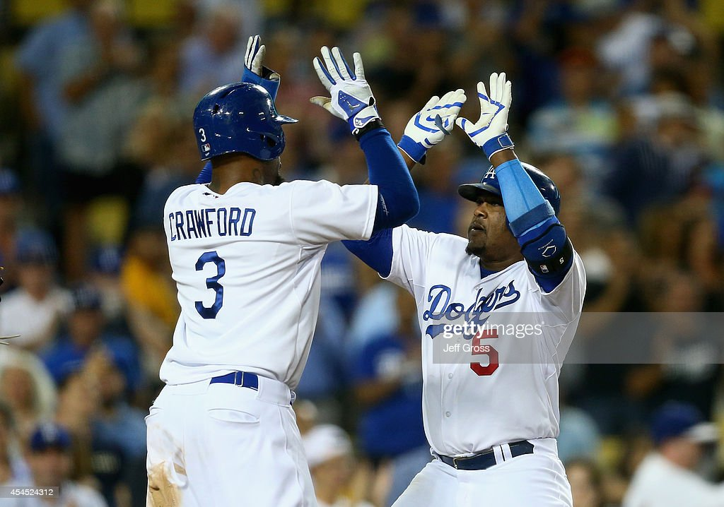 <a gi-track='captionPersonalityLinkClicked' href=/galleries/search?phrase=Juan+Uribe&family=editorial&specificpeople=209187 ng-click='$event.stopPropagation()'>Juan Uribe</a> #5 of the Los Angeles Dodgers is congratulated by <a gi-track='captionPersonalityLinkClicked' href=/galleries/search?phrase=Carl+Crawford&family=editorial&specificpeople=208074 ng-click='$event.stopPropagation()'>Carl Crawford</a> #3 after hitting a two-run home run against the Washington Nationals in the sixth inning at Dodger Stadium on September 2, 2014 in Los Angeles, California.