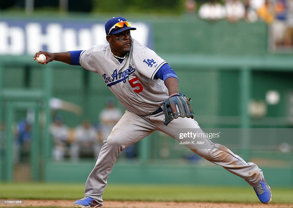 <a gi-track='captionPersonalityLinkClicked' href=/galleries/search?phrase=Juan+Uribe&family=editorial&specificpeople=209187 ng-click='$event.stopPropagation()'>Juan Uribe</a> #5 of the Los Angeles Dodgers makes a throw to first against the Pittsburgh Pirates during the game on June 15, 2013 at PNC Park in Pittsburgh, Pennsylvania. The Dodgers defeated the Pirates 5-3.