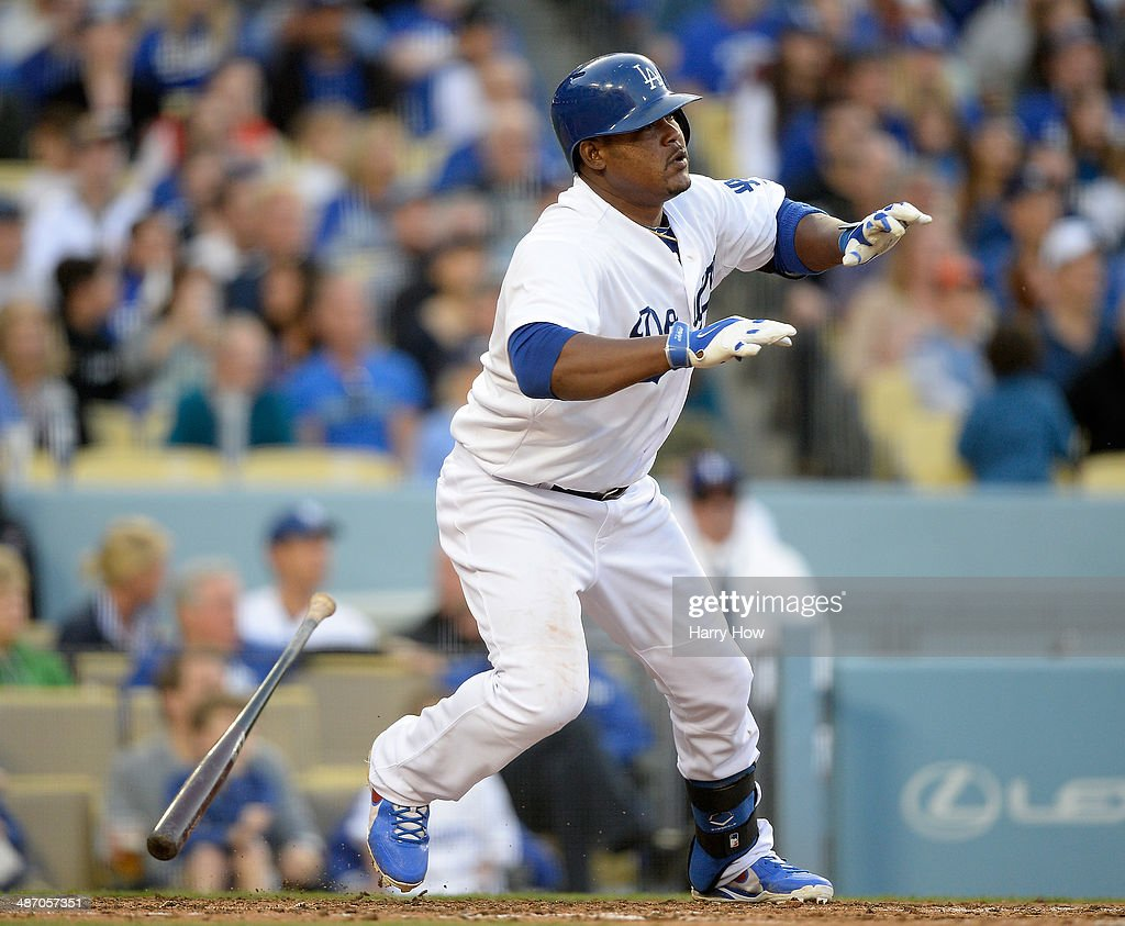 <a gi-track='captionPersonalityLinkClicked' href=/galleries/search?phrase=Juan+Uribe&family=editorial&specificpeople=209187 ng-click='$event.stopPropagation()'>Juan Uribe</a> #5 of the Los Angeles Dodgers reacts to his swing during the game against the Arizona Diamondbacks at Dodger Stadium on April 19, 2014 in Los Angeles, California.