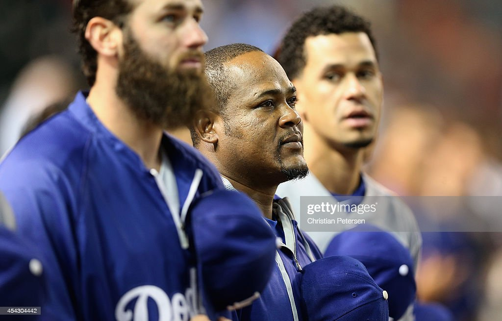 Juan Uribe #5 (C) of the Los Angeles Dodgers stands attended for the National Anthem before the MLB game against the Arizona Diamondbacks at Chase Field on August 26, 2014 in Phoenix, Arizona. The Dodgers defeated the Diamondbacks 9-5.