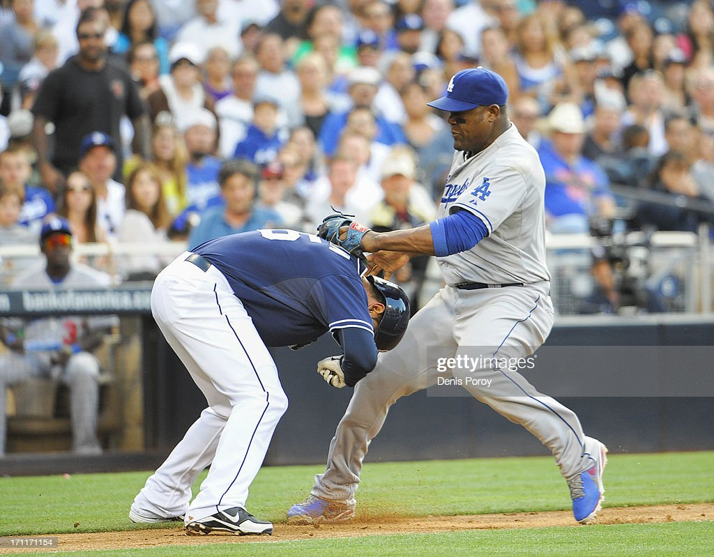 <a gi-track='captionPersonalityLinkClicked' href=/galleries/search?phrase=Juan+Uribe&family=editorial&specificpeople=209187 ng-click='$event.stopPropagation()'>Juan Uribe</a> #5 of the Los Angeles Dodgers tags out Jesus Guzman #15 of the San Diego Padres as he gets caught in a run down between third base and home during the eighth inning of a baseball game at Petco Park on June 22, 2013 in San Diego, California.