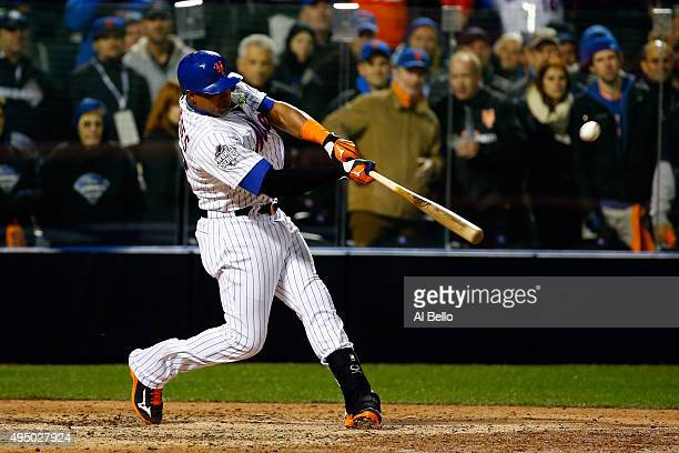 Juan Uribe of the New York Mets hits an RBI single in the sixth inning against the Kansas City Royals during Game Three of the 2015 World Series at...