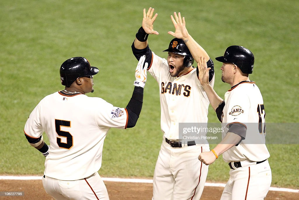 <a gi-track='captionPersonalityLinkClicked' href=/galleries/search?phrase=Juan+Uribe&family=editorial&specificpeople=209187 ng-click='$event.stopPropagation()'>Juan Uribe</a> #5 of the San Francisco Giants celebrates with <a gi-track='captionPersonalityLinkClicked' href=/galleries/search?phrase=Cody+Ross&family=editorial&specificpeople=545810 ng-click='$event.stopPropagation()'>Cody Ross</a> #13 and <a gi-track='captionPersonalityLinkClicked' href=/galleries/search?phrase=Aubrey+Huff&family=editorial&specificpeople=208964 ng-click='$event.stopPropagation()'>Aubrey Huff</a> #17 after hitting a three run homerun in the fifth inning against Darren O'Day #56 of the Texas Rangers in Game One of the 2010 MLB World Series at AT&T Park on October 27, 2010 in San Francisco, California.