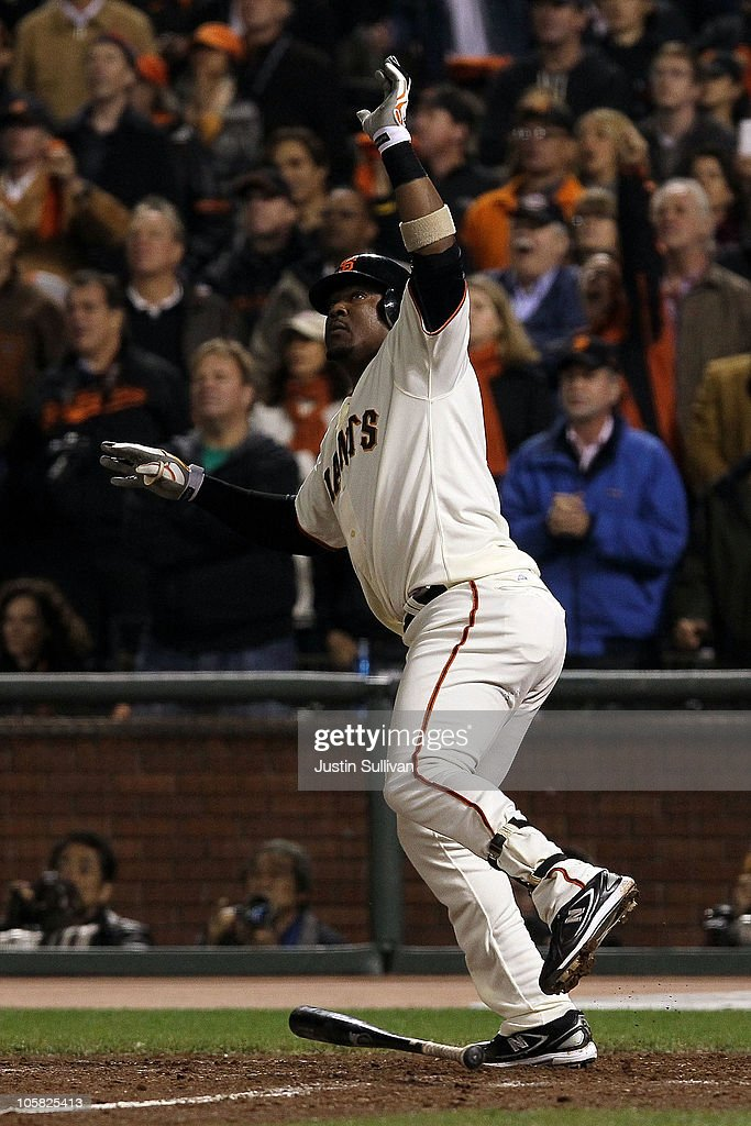 Juan Uribe #5 of the San Francisco Giants reacts after hitting a sacrifice fly that scored Aubrey Huff #17 to win the game 6-5 over the Philadelphia Phillies in Game Four of the NLCS during the 2010 MLB Playoffs at AT&T Park on October 20, 2010 in San Francisco, California.